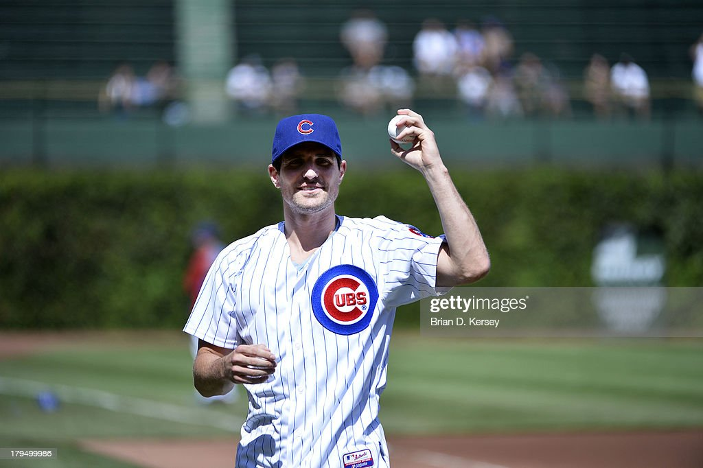 Patrick Sharp #10 of the Chicago Blackhawks gets ready to throw out a ceremonial first pitch before the Chicago Cubs game against the Miami Marlins at Wrigley Field on September 2, 2013 in Chicago, Illinois The Marlins defeated the Cubs 4-3.
