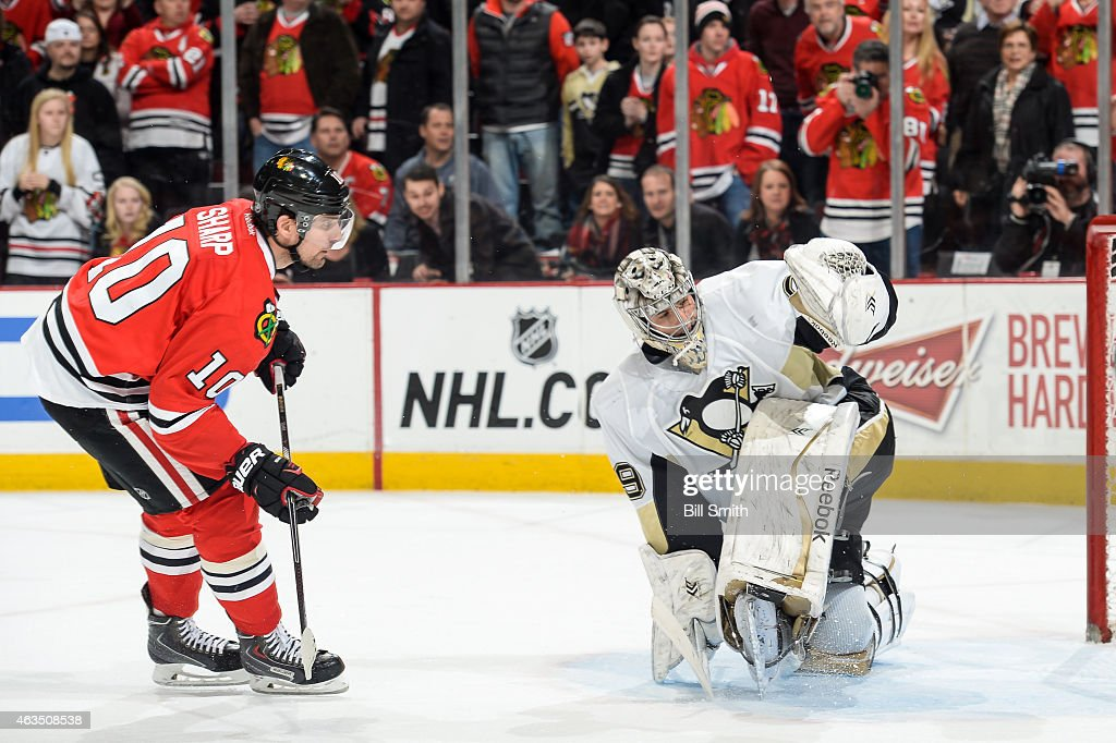 <a gi-track='captionPersonalityLinkClicked' href=/galleries/search?phrase=Patrick+Sharp&family=editorial&specificpeople=206279 ng-click='$event.stopPropagation()'>Patrick Sharp</a> #10 of the Chicago Blackhawks gets the puck past goalie <a gi-track='captionPersonalityLinkClicked' href=/galleries/search?phrase=Marc-Andre+Fleury&family=editorial&specificpeople=233779 ng-click='$event.stopPropagation()'>Marc-Andre Fleury</a> #29 of the Pittsburgh Penguins in the shoot-out, to win the game 2-1, during the NHL game at the United Center on February 15, 2015 in Chicago, Illinois.