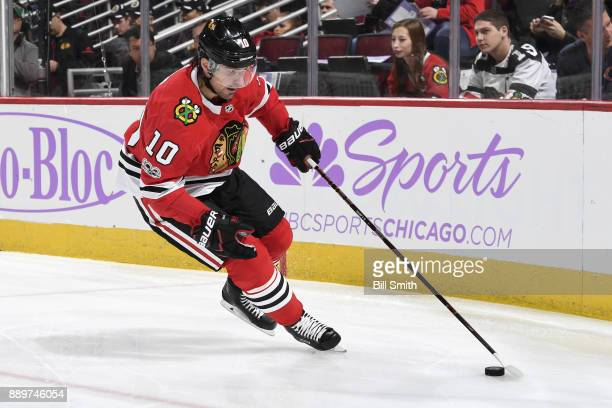 Patrick Sharp of the Chicago Blackhawks grabs the puck in the first period against the Anaheim Ducks at the United Center on November 27 2017 in...
