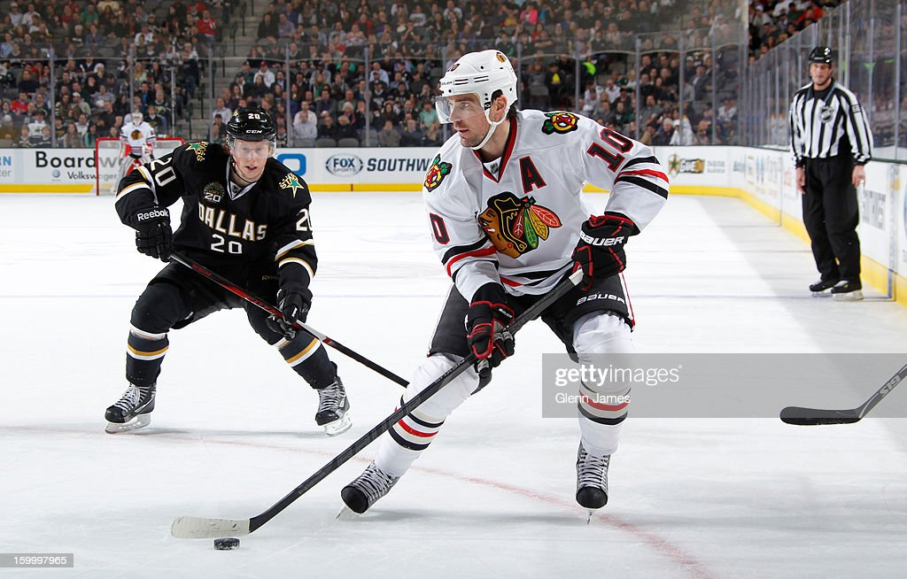 <a gi-track='captionPersonalityLinkClicked' href=/galleries/search?phrase=Patrick+Sharp&family=editorial&specificpeople=206279 ng-click='$event.stopPropagation()'>Patrick Sharp</a> #10 of the Chicago Blackhawks handles the puck against <a gi-track='captionPersonalityLinkClicked' href=/galleries/search?phrase=Cody+Eakin&family=editorial&specificpeople=5662792 ng-click='$event.stopPropagation()'>Cody Eakin</a> #20 of the Dallas Stars at the American Airlines Center on January 24, 2013 in Dallas, Texas.
