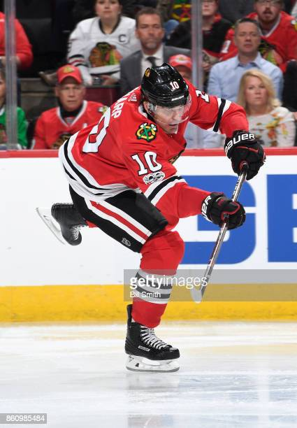 Patrick Sharp of the Chicago Blackhawks hits the puck during the game against the Pittsburgh Penguins at the United Center on October 5 2017 in...