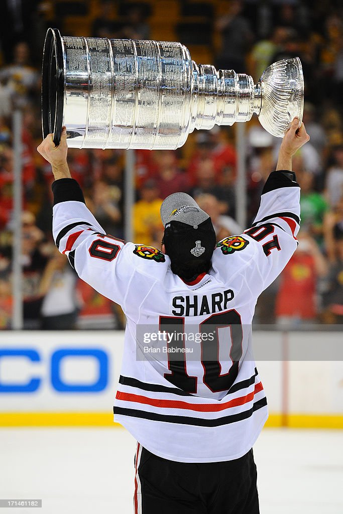 Patrick Sharp #10 of the Chicago Blackhawks hoists the Stanley Cup after the win against the Boston Bruins in Game Six of the Stanley Cup Final at TD Garden on June 24, 2013 in Boston, Massachusetts.