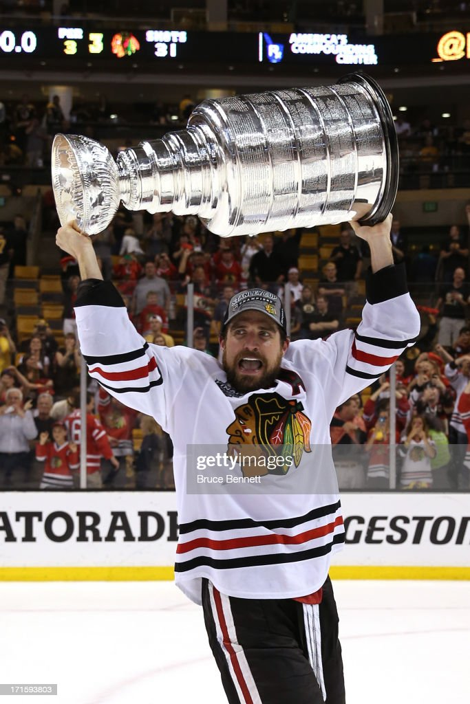 Patrick Sharp #10 of the Chicago Blackhawks hoists the Stanley Cup after defeating the Boston Bruins in Game Six of the 2013 NHL Stanley Cup Final at TD Garden on June 24, 2013 in Boston, Massachusetts. The Chicago Blackhawks defeated the Boston Bruins 3-2.