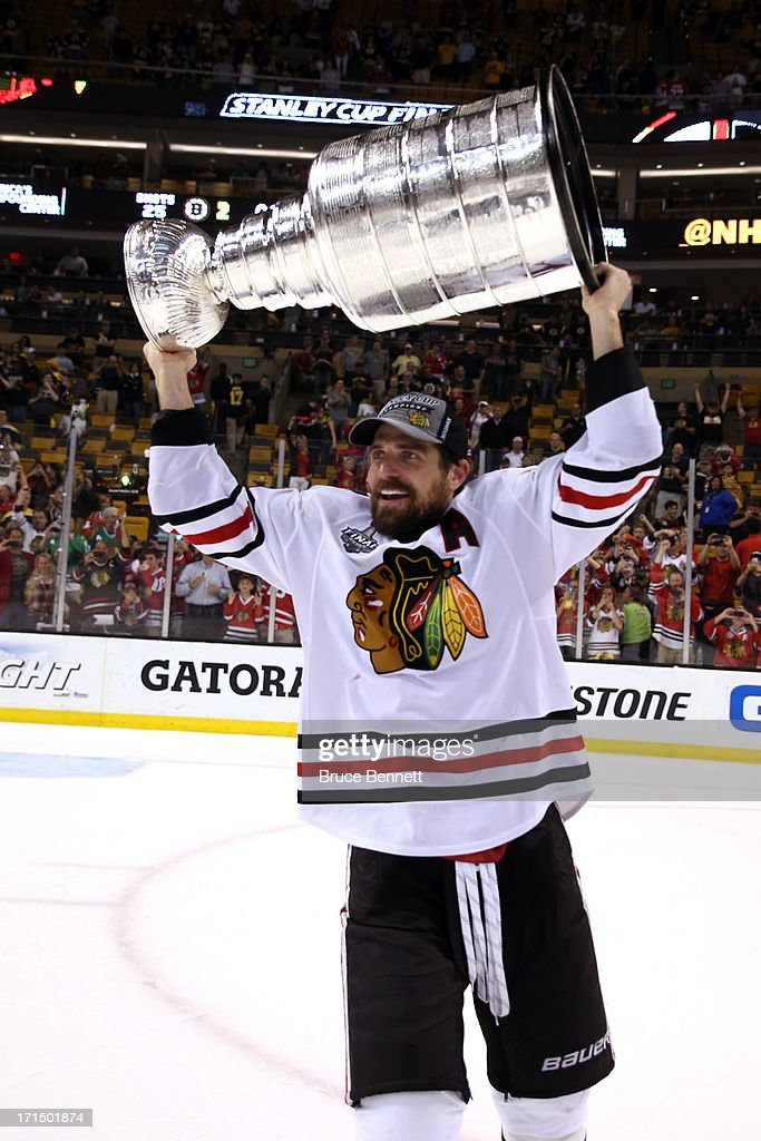 Patrick Sharp #10 of the Chicago Blackhawks hoists the Stanley Cup Trophy after defeating the Boston Bruins in Game Six of the 2013 NHL Stanley Cup Final at TD Garden on June 24, 2013 in Boston, Massachusetts. The Chicago Blackhawks defeated the Boston Bruins 3-2.