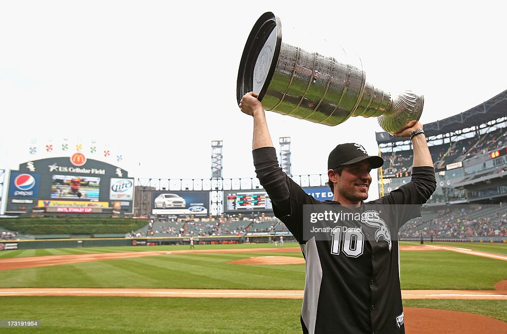 Patrick Sharp #10 of the Chicago Blackhawks holds up the Stanley Cup Trophy before the Chicago White Sox take on the Baltimore Orioles at U.S. Cellular Field on July 3, 2013 in Chicago, Illinois.