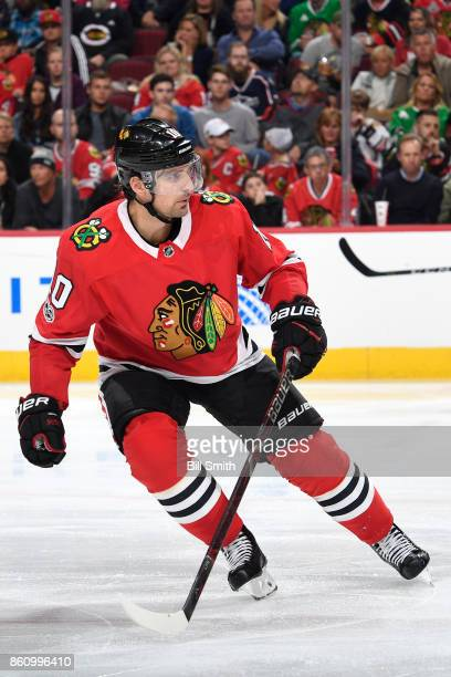 Patrick Sharp of the Chicago Blackhawks looks down the ice during the game against the Columbus Blue Jackets at the United Center on October 7 2017...