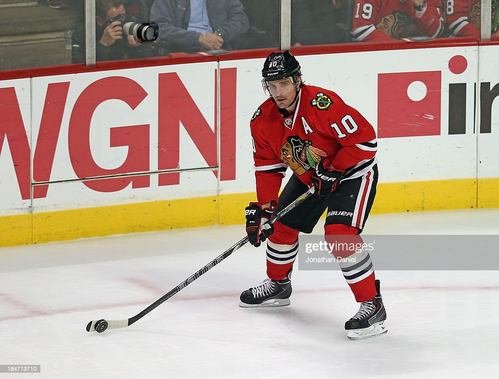 <a gi-track='captionPersonalityLinkClicked' href=/galleries/search?phrase=Patrick+Sharp&family=editorial&specificpeople=206279 ng-click='$event.stopPropagation()'>Patrick Sharp</a> #10 of the Chicago Blackhawks looks to pass against the Buffalo Sabres at the United Center on October 12, 2013 in Chicago, Illinois. The Blackhawks defeated the Sabres 2-1.