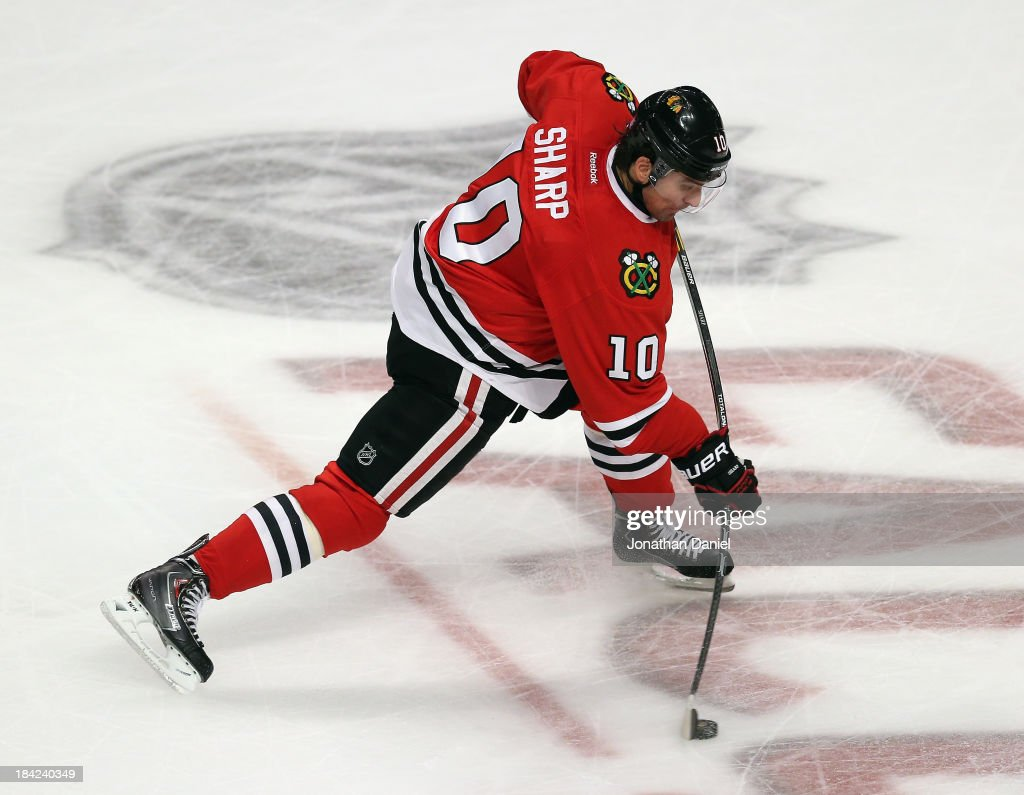 <a gi-track='captionPersonalityLinkClicked' href=/galleries/search?phrase=Patrick+Sharp&family=editorial&specificpeople=206279 ng-click='$event.stopPropagation()'>Patrick Sharp</a> #10 of the Chicago Blackhawks, playing in his 600th NHL game, fires a shot against the Buffalo Sabres at the United Center on October 12, 2013 in Chicago, Illinois.