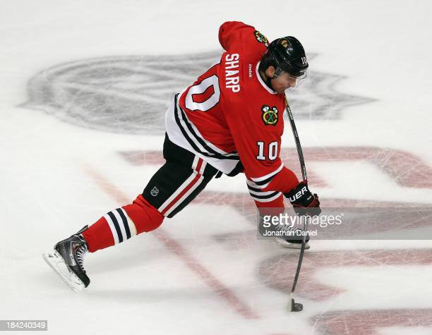 Patrick Sharp of the Chicago Blackhawks playing in his 600th NHL game fires a shot against the Buffalo Sabres at the United Center on October 12 2013...