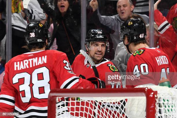 Patrick Sharp of the Chicago Blackhawks reacts after scoring against the Nashville Predators in the third period at the United Center on October 14...