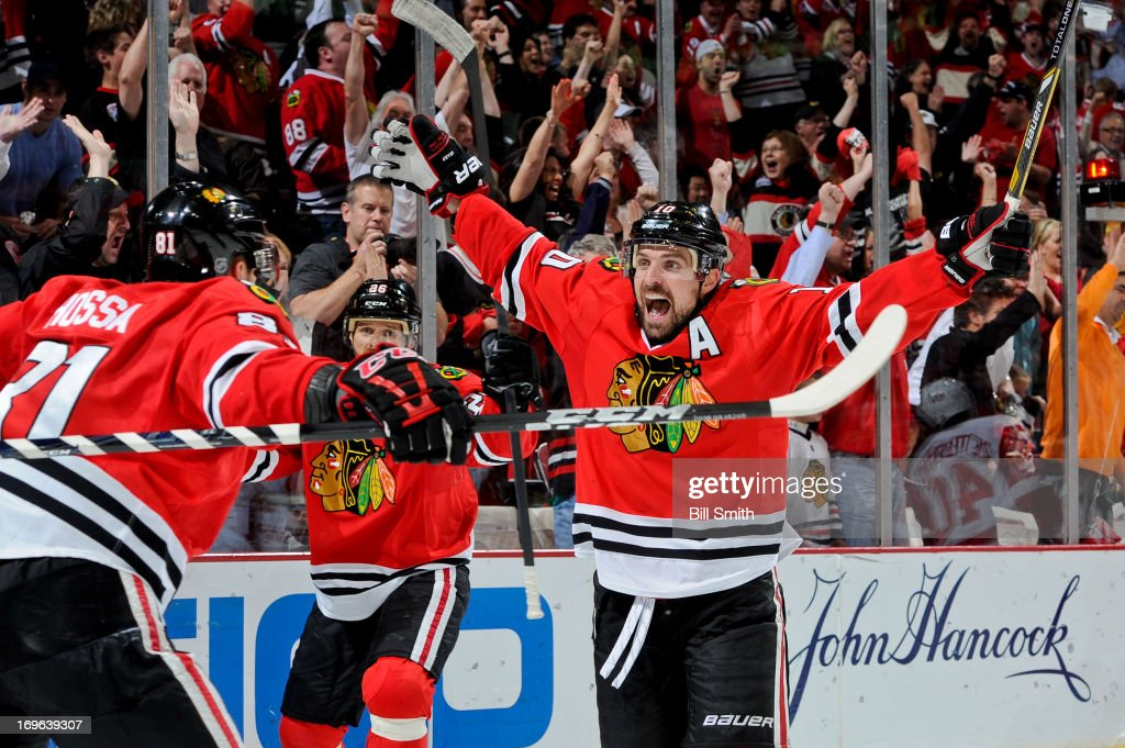 <a gi-track='captionPersonalityLinkClicked' href=/galleries/search?phrase=Patrick+Sharp&family=editorial&specificpeople=206279 ng-click='$event.stopPropagation()'>Patrick Sharp</a> #10 of the Chicago Blackhawks reacts after scoring in the second period against the Detroit Red Wings in Game Seven of the Western Conference Semifinals during the 2013 Stanley Cup Playoffs at the United Center on May 29, 2013 in Chicago, Illinois.