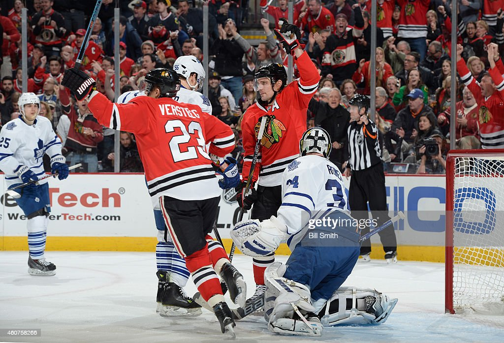<a gi-track='captionPersonalityLinkClicked' href=/galleries/search?phrase=Patrick+Sharp&family=editorial&specificpeople=206279 ng-click='$event.stopPropagation()'>Patrick Sharp</a> #10 of the Chicago Blackhawks reacts in front of goalie <a gi-track='captionPersonalityLinkClicked' href=/galleries/search?phrase=James+Reimer+-+Hockey+Player&family=editorial&specificpeople=7543302 ng-click='$event.stopPropagation()'>James Reimer</a> #34 of the Toronto Maple Leafs after <a gi-track='captionPersonalityLinkClicked' href=/galleries/search?phrase=David+Rundblad&family=editorial&specificpeople=5649675 ng-click='$event.stopPropagation()'>David Rundblad</a> #5 (not pictured) scored in the first period during the NHL game at the United Center on December 21, 2014 in Chicago, Illinois.
