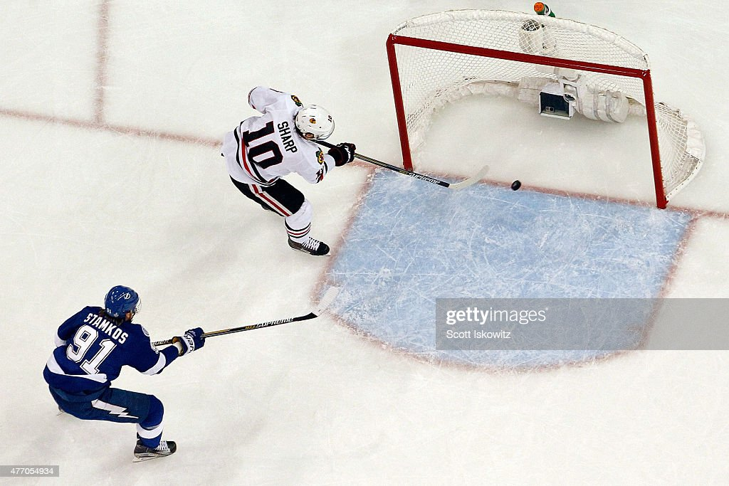 <a gi-track='captionPersonalityLinkClicked' href=/galleries/search?phrase=Patrick+Sharp&family=editorial&specificpeople=206279 ng-click='$event.stopPropagation()'>Patrick Sharp</a> #10 of the Chicago Blackhawks scores an empty net goal in the first period past <a gi-track='captionPersonalityLinkClicked' href=/galleries/search?phrase=Steven+Stamkos&family=editorial&specificpeople=4047623 ng-click='$event.stopPropagation()'>Steven Stamkos</a> #91 of the Tampa Bay Lightning during Game Five of the 2015 NHL Stanley Cup Final at Amalie Arena on June 13, 2015 in Tampa, Florida.