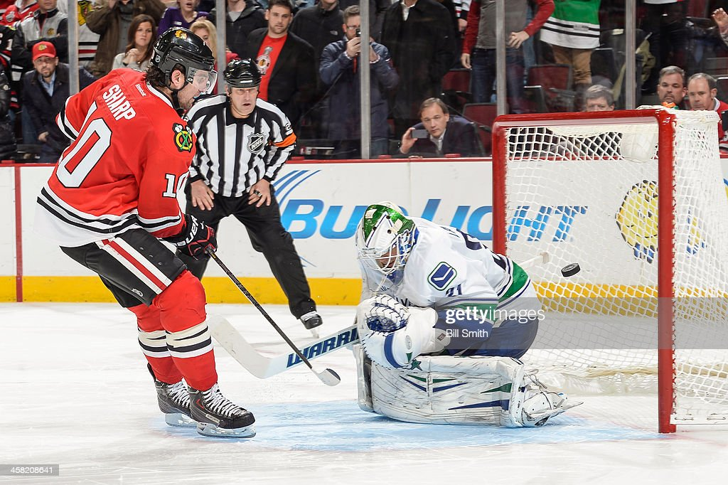 <a gi-track='captionPersonalityLinkClicked' href=/galleries/search?phrase=Patrick+Sharp&family=editorial&specificpeople=206279 ng-click='$event.stopPropagation()'>Patrick Sharp</a> #10 of the Chicago Blackhawks scores in the shoot-out against goalie Eddie Lack #31 of the Vancouver Canucks during the NHL game on December 20, 2013 at the United Center in Chicago, Illinois.