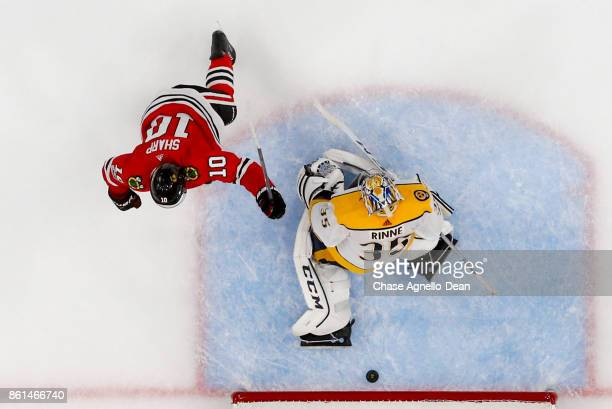 Patrick Sharp of the Chicago Blackhawks scores on goalie Pekka Rinne of the Nashville Predators in the third period at the United Center on October...