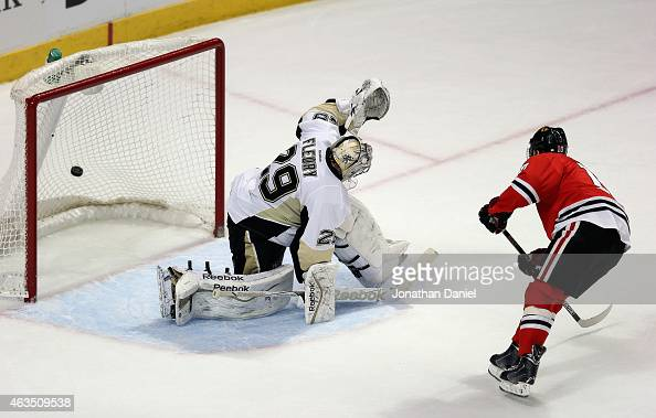 Patrick Sharp of the Chicago Blackhawks scores the gamewinning goal in the shootout against MarcAndre Fleury of the Pittsburgh Penguins at the United...