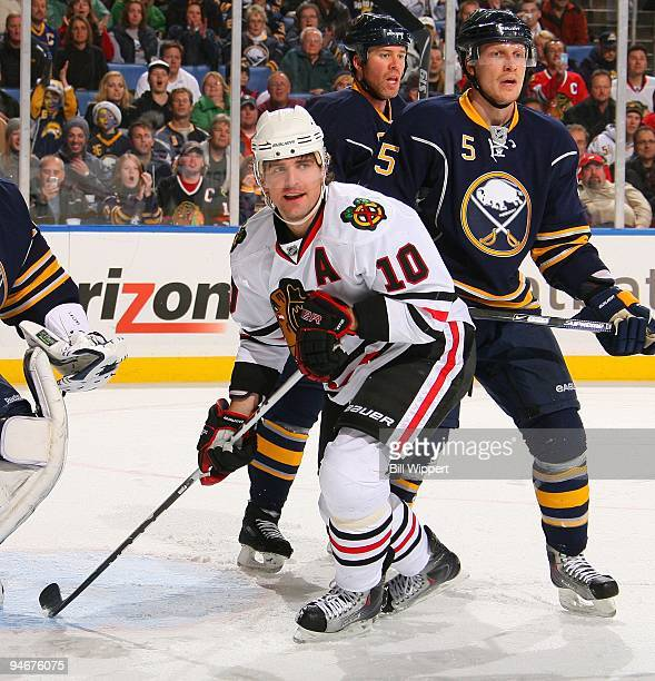 Patrick Sharp of the Chicago Blackhawks skates against Toni Lydman of the Buffalo Sabres on December 11 2009 at HSBC Arena in Buffalo New York