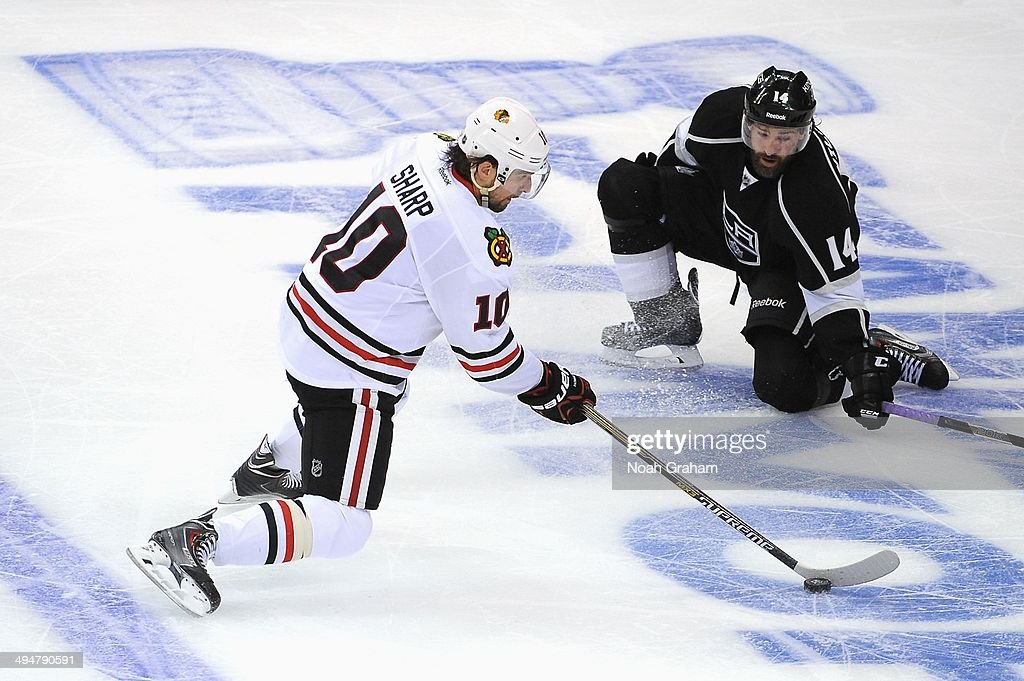 <a gi-track='captionPersonalityLinkClicked' href=/galleries/search?phrase=Patrick+Sharp&family=editorial&specificpeople=206279 ng-click='$event.stopPropagation()'>Patrick Sharp</a> #10 of the Chicago Blackhawks skates with the puck against Justin Williams #14 of the Los Angeles Kings in Game Six of the Western Conference Final during the 2014 Stanley Cup Playoffs at Staples Center on May 30, 2014 in Los Angeles, California.