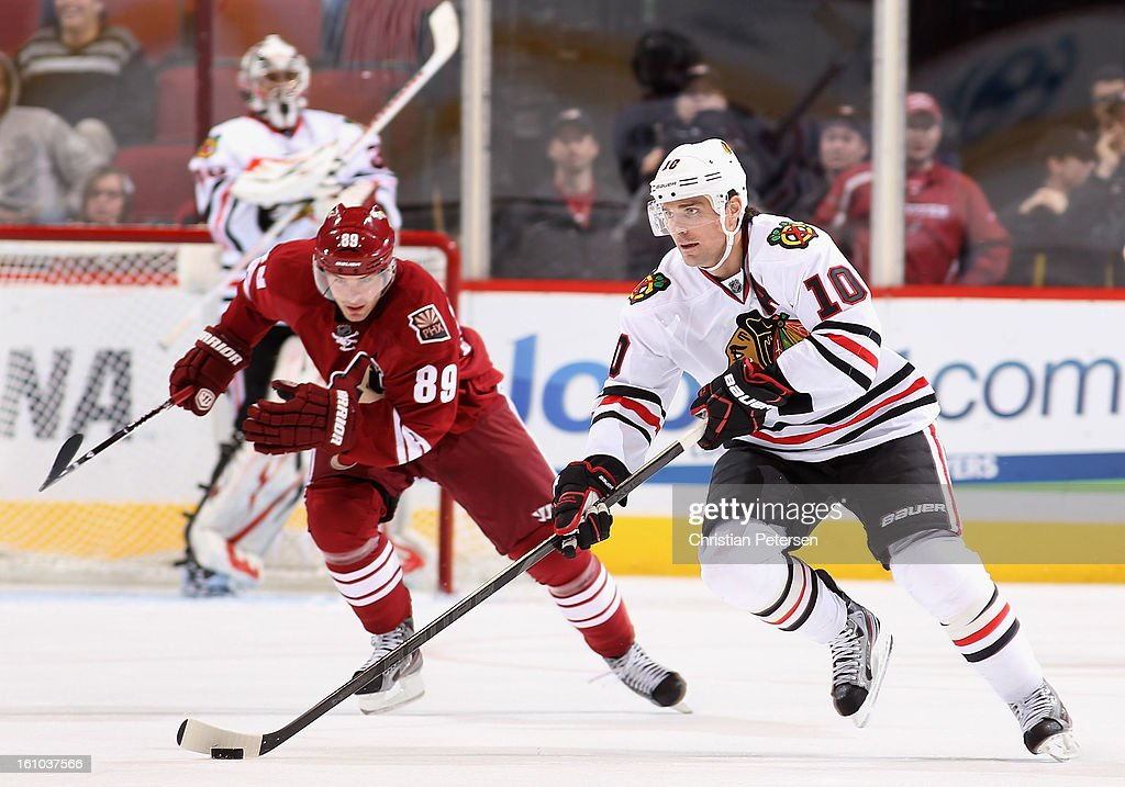 <a gi-track='captionPersonalityLinkClicked' href=/galleries/search?phrase=Patrick+Sharp&family=editorial&specificpeople=206279 ng-click='$event.stopPropagation()'>Patrick Sharp</a> #10 of the Chicago Blackhawks skates with the puck past Mikkel Boedker #89 of the Phoenix Coyotes during the NHL game at Jobing.com Arena on February 7, 2013 in Glendale, Arizona. The Blackhawks defeated the Coyotes 6-2.