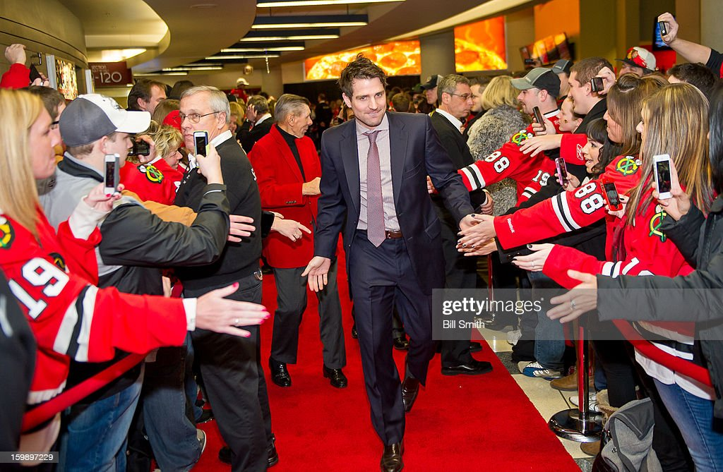 Patrick Sharp #10 of the Chicago Blackhawks slaps hands with fans before the NHL game against the St. Louis Blues on January 22, 2013 at the United Center in Chicago, Illinois.