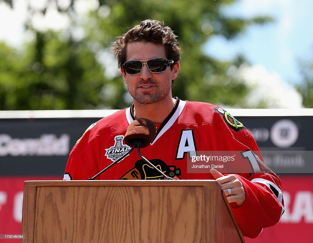 Patrick Sharp #10 of the Chicago Blackhawks speaks to the crowd during the Chicago Blackhawks Victory Parade and Rally on June 28, 2013 in Chicago, Illinois.