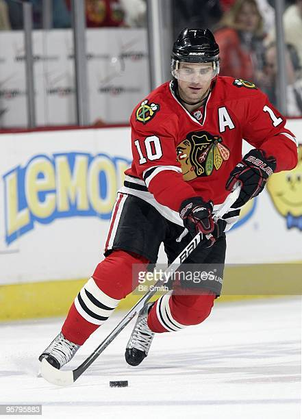 Patrick Sharp of the Chicago Blackhawks takes control of the puck during a game against the Anaheim Ducks on January 10 2010 at the United Center in...