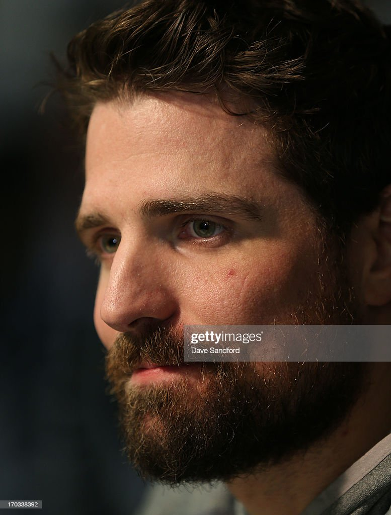 Patrick Sharp #10 of the Chicago Blackhawks talks with reporters during the 2013 Stanley Cup Final Media Day at the United Center on June 11, 2013 in Chicago, Illinois.
