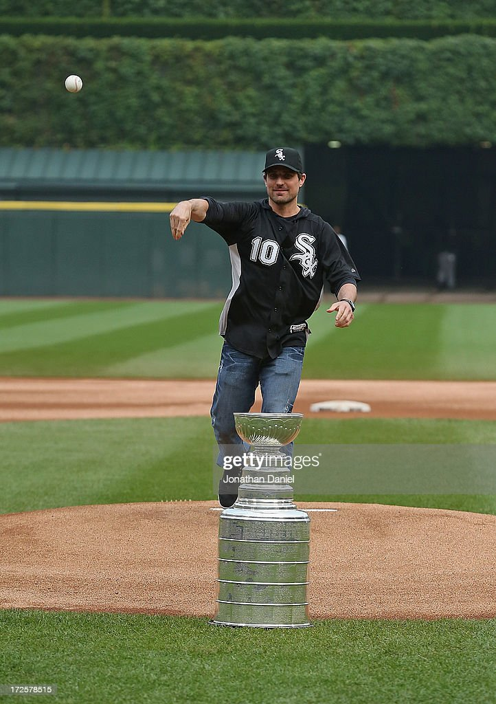 Patrick Sharp #10 of the Chicago Blackhawks throws a ceremonial first pitch over the Stanley Cup before the Chicago White Sox take on the Baltimore Orioles at U.S. Cellular Field on July 3, 2013 in Chicago, Illinois.