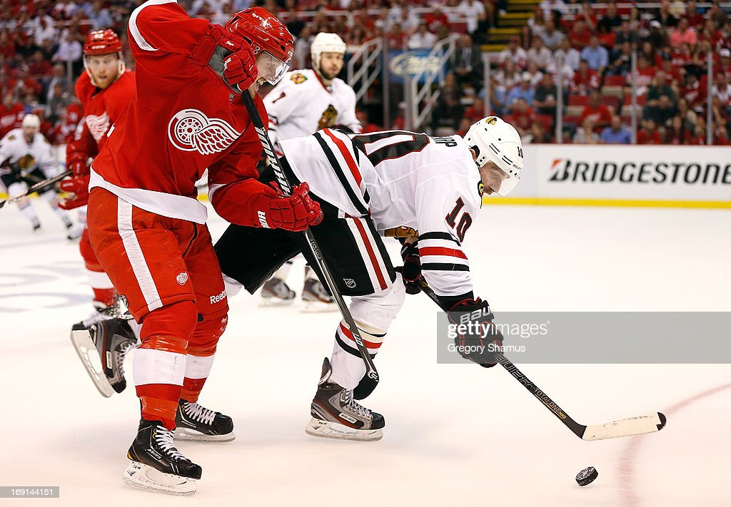 <a gi-track='captionPersonalityLinkClicked' href=/galleries/search?phrase=Patrick+Sharp&family=editorial&specificpeople=206279 ng-click='$event.stopPropagation()'>Patrick Sharp</a> #10 of the Chicago Blackhawks tries to control the puck in front of <a gi-track='captionPersonalityLinkClicked' href=/galleries/search?phrase=Gustav+Nyquist&family=editorial&specificpeople=5491209 ng-click='$event.stopPropagation()'>Gustav Nyquist</a> #14 of the Detroit Red Wings during the third period in Game Three of the Western Conference Semifinals during the 2013 NHL Stanley Cup Playoffs at Joe Louis Arena on May 20, 2013 in Detroit, Michigan. Detroit won the game 3-1 to take a 2-1 series lead.