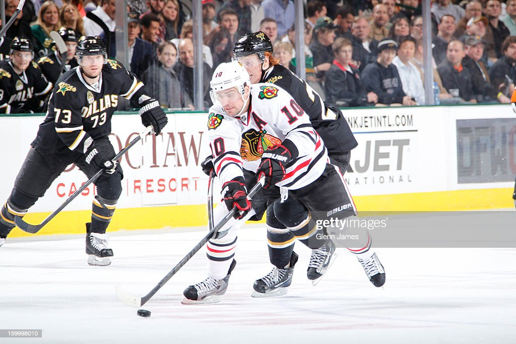 <a gi-track='captionPersonalityLinkClicked' href=/galleries/search?phrase=Patrick+Sharp&family=editorial&specificpeople=206279 ng-click='$event.stopPropagation()'>Patrick Sharp</a> #10 of the Chicago Blackhawks tries to keep the puck away against <a gi-track='captionPersonalityLinkClicked' href=/galleries/search?phrase=Cody+Eakin&family=editorial&specificpeople=5662792 ng-click='$event.stopPropagation()'>Cody Eakin</a> #20 of the Dallas Stars at the American Airlines Center on January 24, 2013 in Dallas, Texas.