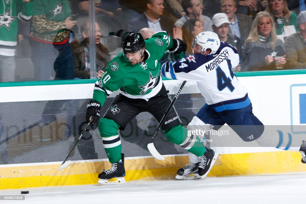 Patrick Sharp #10 of the Dallas Stars tries to get away from Josh Morrissey #44 of the Winnipeg Jets at the American Airlines Center on February 2, 2017 in Dallas, Texas.