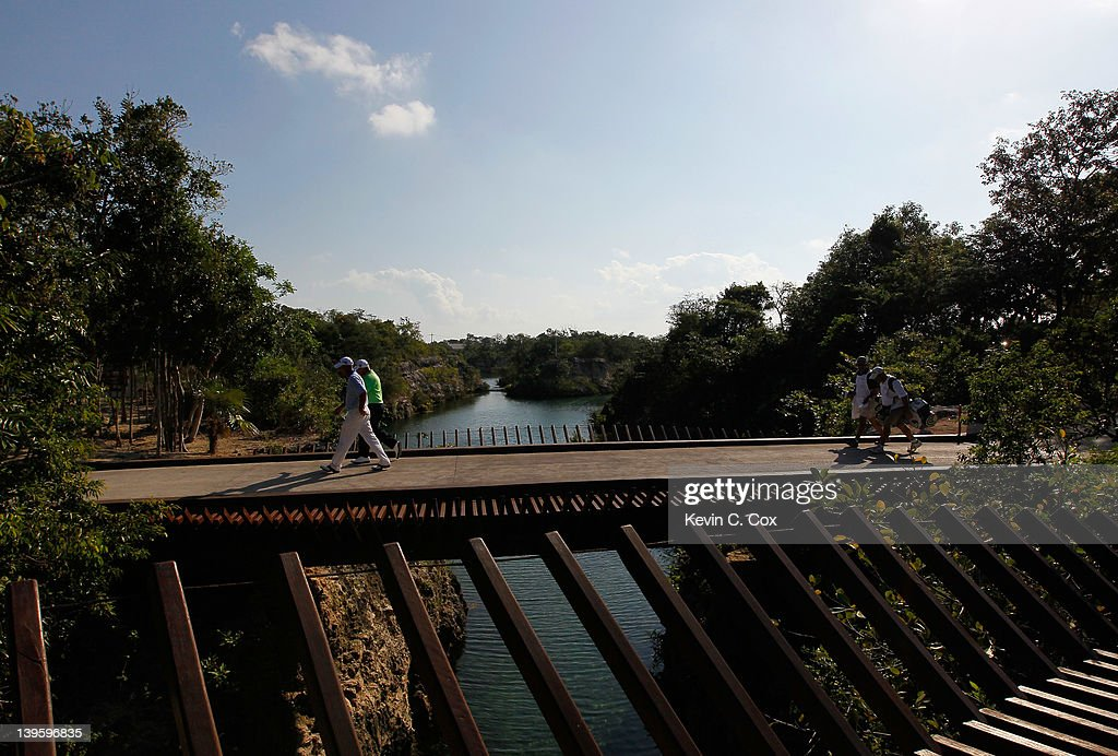 Patrick Sheehan and Roland Thatcher, both of the United States, cross the bridge to the seventh hole during the first round of the Mayakoba Golf Classic at Riviera Maya-Cancún held at El Camaleon Golf Club at Mayakoba on February 23, 2012 in Playa del Carmen, Mexico.