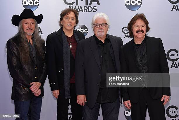 Patrick Simmons John McFee Michael McDonald and Tom Johnston of the Doobie Brothers attend the 48th annual CMA Awards at the Bridgestone Arena on...