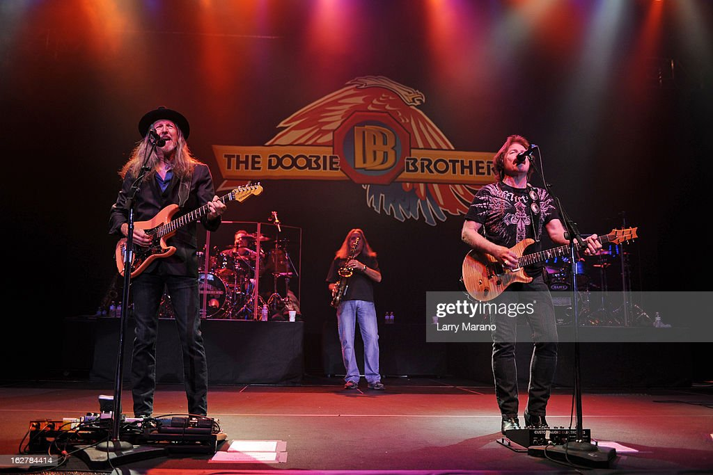 Patrick Simmons, Tom Johnston and John McFee of The Doobie Brothers perform at Hard Rock Live! in the Seminole Hard Rock Hotel & Casino on February 26, 2013 in Hollywood, Florida.