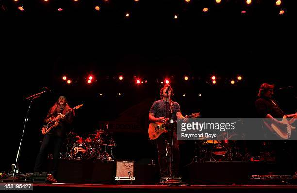 Patrick Simmons Tom Johnston and John McFee of the Doobie Brothers performs on the Briggs Stratton Big Backyard Stage at the Henry W Maier Festival...