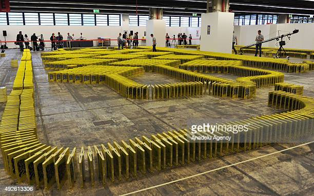 Patrick Sinner and his team break the new bookdomino world record during the 2015 Frankfurt Book Fair in Frankfurt am Main Germany 14 October 2015...