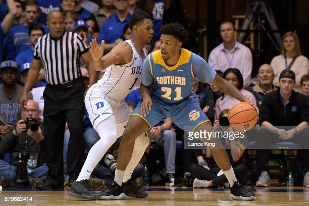 Patrick Smith of the Southern Jaguars moves the ball against Trevon Duval of the Duke Blue Devils at Cameron Indoor Stadium on November 17 2017 in...