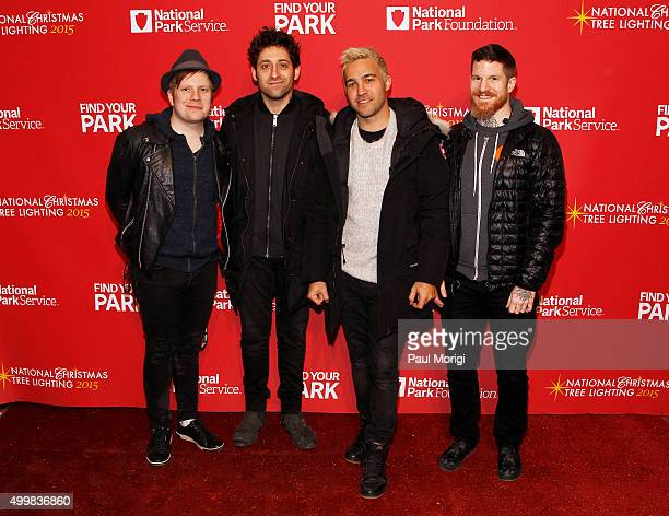 Patrick Stump Joe Trohman Pete Wentz and Andy Hurley of Fall Out Boy attend the 93rd Annual National Christmas Tree Lighting at The Ellipse on...