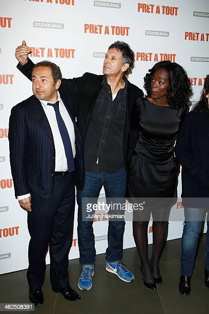 Patrick Timsit Nicolas Cuche and Aissa Maiga attend 'Pret A Tout' Paris Premiere at Cinema Gaumont Marignan on January 13 2014 in Paris France