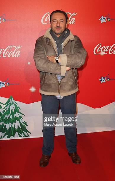 Patrick Timsit poses at the Coca Cola Christmas windows inauguration at Le Showcase on November 26 2012 in Paris France