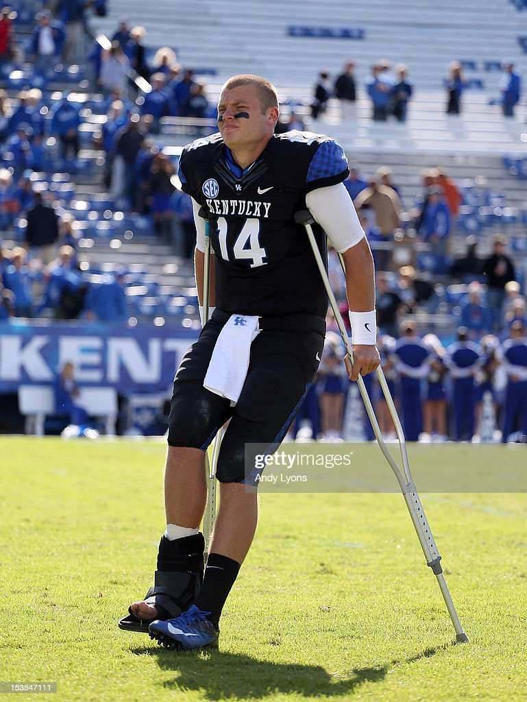 Patrick Towles #14 of the Kentucky Wildcats walks off of the field on crutches following the SEC game against the Mississippi State Bulldogs at Commonwealth Stadium on October 6, 2012 in Lexington, Kentucky. He was injured in the first half of the 27-14 loss.