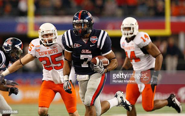 Patrick Trahan of the Mississippi Rebels returns a fumlbe recovery for a touchdown against the Oklahoma State Cowboys during the ATT Cotton Bowl on...