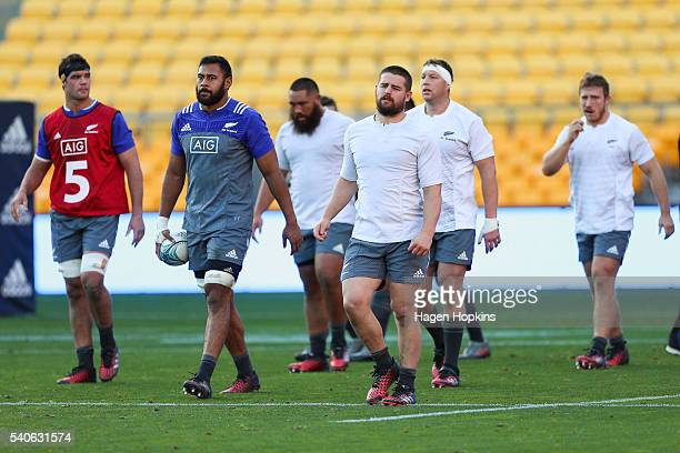 Patrick Tuipulotu and Dane Coles look on during a New Zealand All Blacks training session at Westpac Stadium on June 16 2016 in Wellington New Zealand