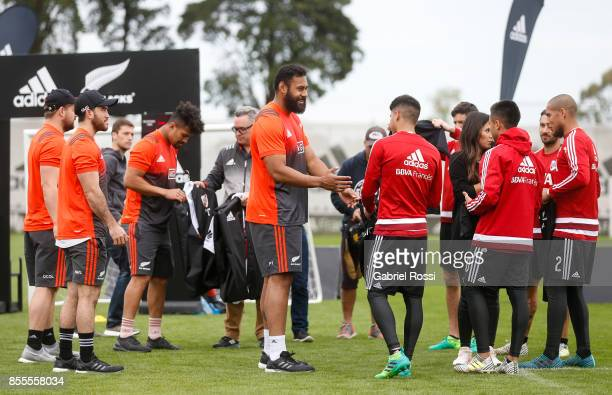 Patrick Tuipulotu of All Blacks exchanges jerseys with River Plate players during the New Zealand Rugby Championship Media Day ahead of the match...