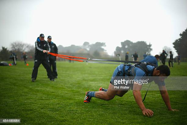 Patrick Tuipulotu of the All Blacks practices his scrum technique during a New Zealand All Blacks Training Session at Marist Old Boys Rugby Club on...