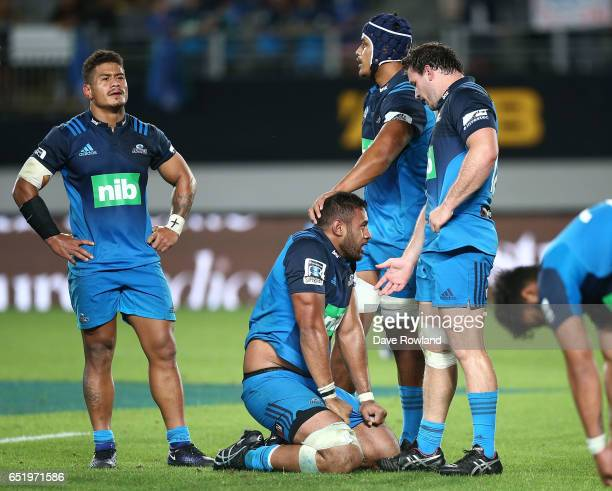 Patrick Tuipulotu of the Blues is consoled after defeat in the round three Super Rugby match between the Blues and the Highlanders at Eden Park on...