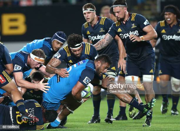 Patrick Tuipulotu of the Blues is tackled by Jackson Hemopo of the Highlanders during the round three Super Rugby match between the Blues and the...