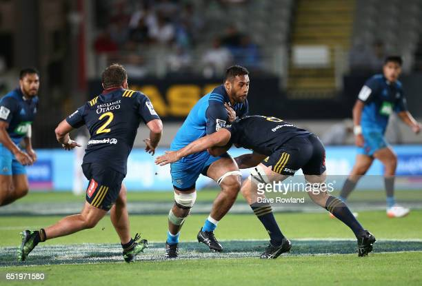 Patrick Tuipulotu of the Blues is tackled by Luke Whitelock of the Highlanders during the round three Super Rugby match between the Blues and the...