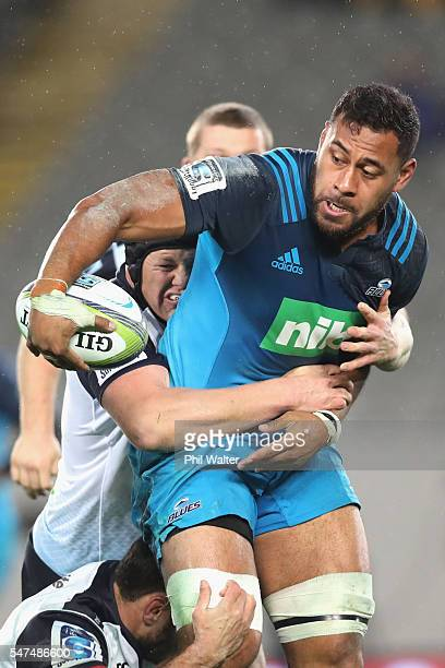 Patrick Tuipulotu of the Blues is tackled by Paddy Ryan of the Waratahs during the round 17 Super Rugby match between the Blues and the Waratahs at...
