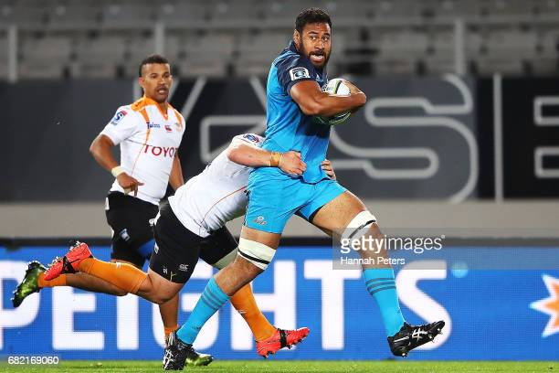 Patrick Tuipulotu of the Blues makes a break to score a try during the round 12 Super Rugby match between the Blues and the Cheetahs at Eden Park on...